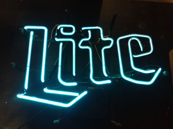 Neon beer sign Miller lite bar cave
