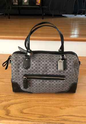 Coach purse used a few times. Beautiful purple liner inside. The width of the bottom is 1 ft and it is spacious inside. Original price was over $200. for Sale in Tyngsborough, MA