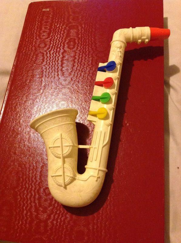 Vintage prolls toys inc saxophone