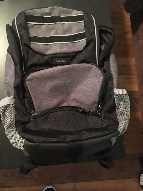 Calvin Klein designer backpack with many pockets and slots for your Laptop and Tablet.
