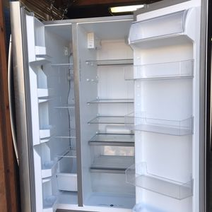 Whirlpool Refrigerator Side by Side Stainless Steel About A Year And A Half New. Too Big For The Area In Our Kitchen. for Sale in Burlingame, CA