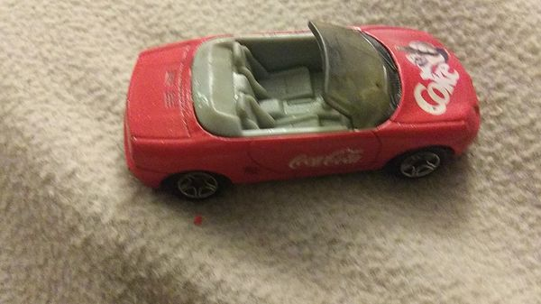 3 Coke Cars