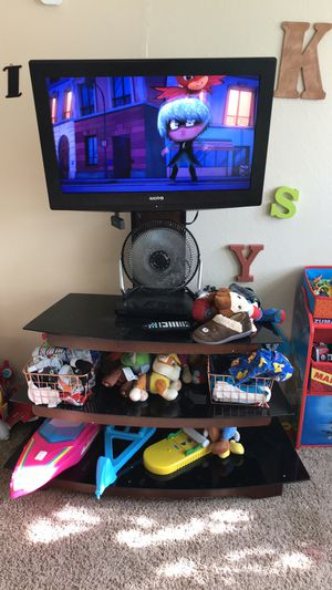 Tv with tv stand for Sale in Granbury, TX