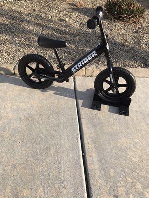 "12"" boys 12"" Strider Balance bike for Sale in Visalia, CA"
