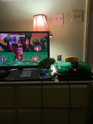 Jungle green n64 w/ 1 game & 1 controller for Sale in San Antonio, TX
