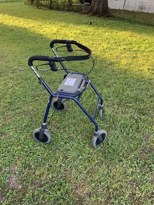 Walker with brakes and seat for Sale in Polk City, FL