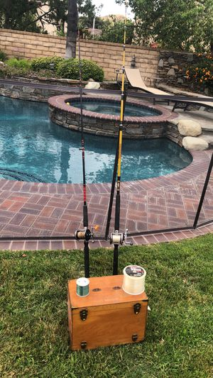 Two Saltwater Fishing Rods with Penn Reels with Wood Tackle Box full of lures,Jigs,2 spools of line. for Sale in Santa Clarita, CA