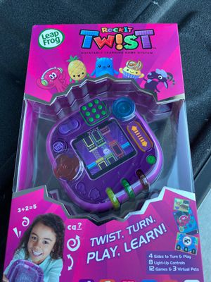New LeapFrog RockIt Twist Handheld Learning Game System, Purple for Sale in Houston, TX