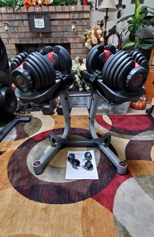 Bowflex Adjustable Dumbbell Set with Brand New Stand and... for Sale in Lynnwood, WA