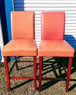 2 bar height red vinyl covered dark wood stools for Sale in Medford, OR