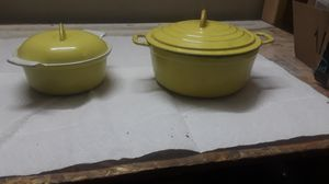 2-Yellow cast iron Dutch oven pans. Small 3cup and small medium #6 size. Perfect if you are cooking for two, a couple of chips, but good condition. for Sale in Oakland, CA