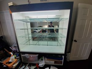 Toy collectible display case with glass shelves, sliding glass doors, and shelf racks for Sale in Anaheim, CA