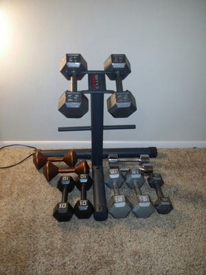 Weider weight rack that holds a pair of dumbbells and 2 sides for weights. Dumbbells 2x25lb, 2x15lb, 2x10lb, 3x8lb, 2x5lb. for Sale in Deerfield Beach, FL