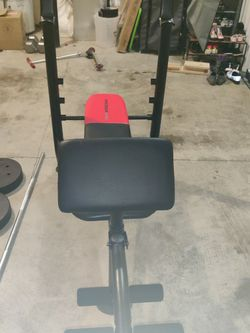 Weider Pro bench press with 130lb weights. for Sale in Boring,  OR