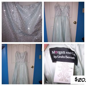 Morgan and Company By Linda BERNELL, brand new with tags, size 5/6 Light green long formal dress with sparkly bodice And corseted back for Sale in Phoenix, AZ