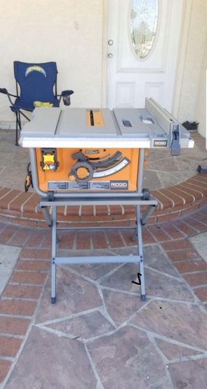 RIDGID 15 Amp Corded 10 in. Compact Table Saw with Carbide Tipped Blade and Folding X-Stand for Sale in Santa Ana, CA