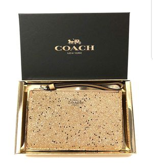 NWT In Gift Box COACH Gold Glitter Star Wristlet Glam Sparkle $85 Retail NEW!. Condition is New for Sale in Germantown, MD