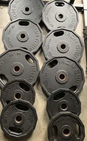 OLYMPIC BARBELL PLATES / Iron grip for Sale in Kent, WA