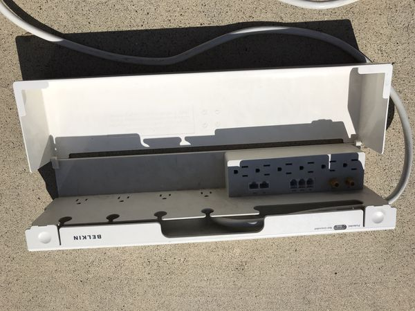 Belkin power surge protector with 11 outlets, protective cover, and long cable