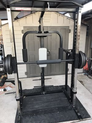 Body solid smith machine with body solid bench dip station pull up station and cable system with 6 attachments and 300lbs of weight and barbell pad for Sale in Fort Worth, TX