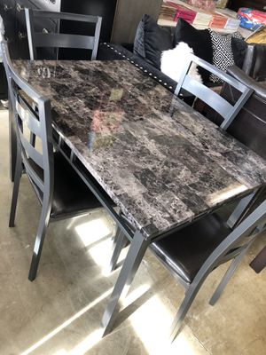 Furniture table with four El Rio furniture finance available down payment $39 1456 belt line rd suite 121 Garland tx 75044 Open from 9:30-8:30 for Sale in Richardson, TX
