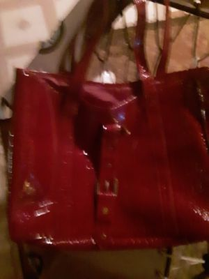 Huge maroon patent leather bag..inside pocket zipper works straps are a lil worn..but overall a good buy for Sale in North Platte, NE