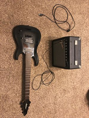 Jackson 7 string guitar and small fender amp (no strings on guitar and amp comes with power cable) for Sale in Belleville, IL