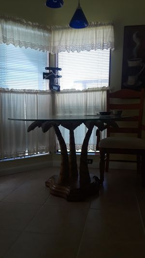Glass tabletop kitchen table. 3 palm tree base for Sale in Lake Worth, FL