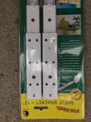 """Folding 12"""" shelf brackets for Sale in Charlotte, NC"""