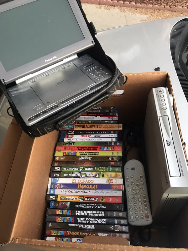 Box of DVDs & Portable player (perfect for road trips)