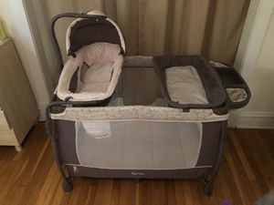 Baby play pan with a bassinet and a changing table all in one for Sale in Chicago, IL