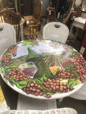 Vintage metal patio table with right iron base winery scene painted with three layers of clear includes four vintage wicker patio chairs for Sale in Visalia, CA