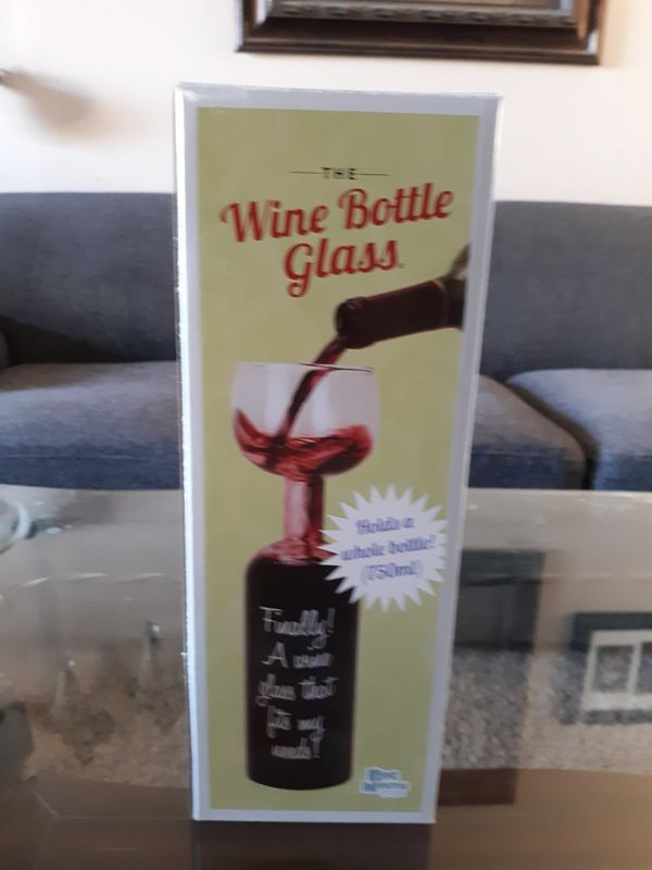 Huge wine bottle with wine glass on top. stands almost 12in tall.