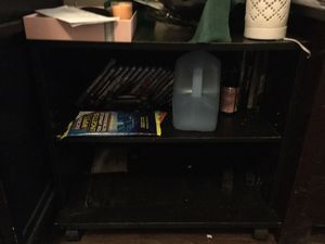 Small black cabinet on wheels for Sale in Raleigh, NC