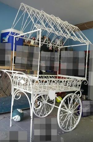 This carriage is for your special occasion decor.. easy to disassemble and reassemble. Rustic painting on the carriage. Rolls easily to move around for Sale in Sterling Heights, MI