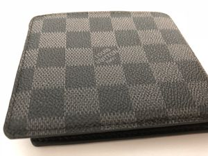 Men's fancy wallet designer shipping only. for Sale in Colma, CA
