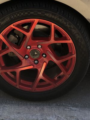 """18"""" rims red looking to trade for black rims for Sale in Haltom City, TX"""