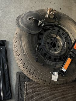 Nissan Frontier Spare Tire, Tools, Jacket, Mount for Sale in Orange,  CA