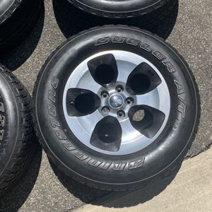 4 Bridgestone Dueler AT mounted on Jeep wheels for Sale in Bronxville, NY
