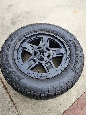 """4-20""""Rockstar rims/ 33""""Falken Wildpeak tires 6x 135 and 6x5.5 dual bolt pattern with two different inserts, one red, one black, can be swapped out for Sale in Downey, CA"""