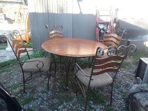 Round dining table with iron solid wood 4 chairs good condition asking 280 delivered or best for Sale in Houston, TX
