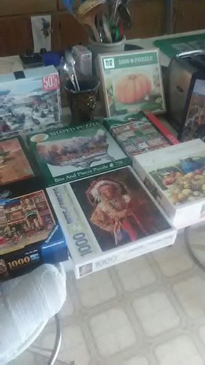 12 PUZZLES.. A FEW NEVER BEEN OPEN for Sale in Tucson, AZ