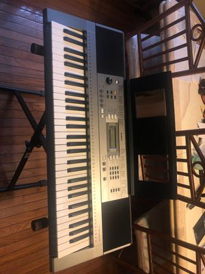 Musical keyboard with stand and learning guides for Sale in Harvey, IL