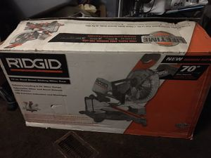NEW RIDGID 15 Amp Corded 12 in. Dual Bevel Sliding Miter Saw with 70° Miter Capacity for Sale in Tampa, FL