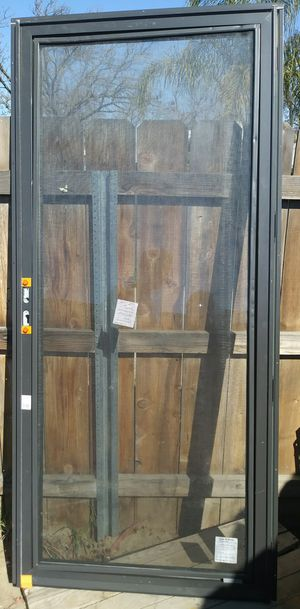 Nice glass storm door with screen for Sale in Fresno, CA