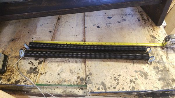 25 inch Garage door springs, new.