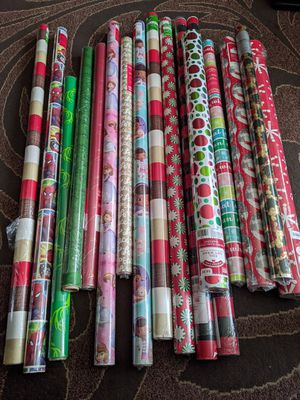 17 rolls of Christmas and other Holidays gift wraping paper. All new for Sale in Everett, WA
