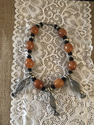 Silvertone and amber colored necklace for Sale in San Leandro, CA
