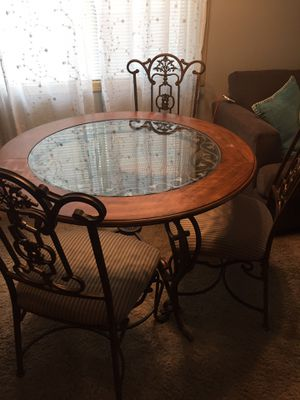 Ashley Furniture Wrought Iron Kitchen Table & Matching Wine Cabinet for Sale in Everett, WA