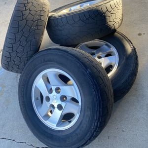 Toyota sequoia 16 OEM wheels rims All season tires for Sale in Highlands Ranch, CO